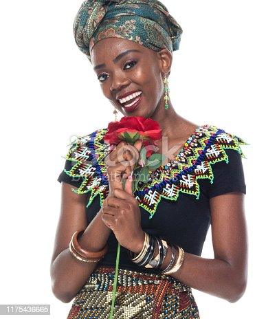 istock Full length / headshot / profile view of 20-29 years old african ethnicity / african-american ethnicity female / young women in front of white background wearing headscarf / dress / traditional clothing / romance / valentine's day - holiday 1175436665