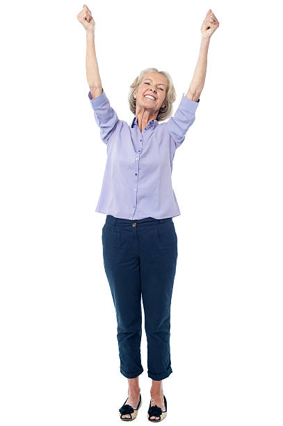 Full length image of excited aged lady stock photo