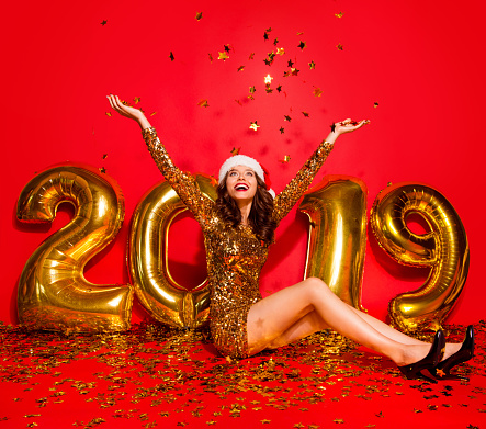 Full length, legs, body, size portrait of careless, carefree, dream, dreamy lady in sharp, pumps, stilettos, modern wave hairdro sit on the floor raised hands up isolated on bright red background