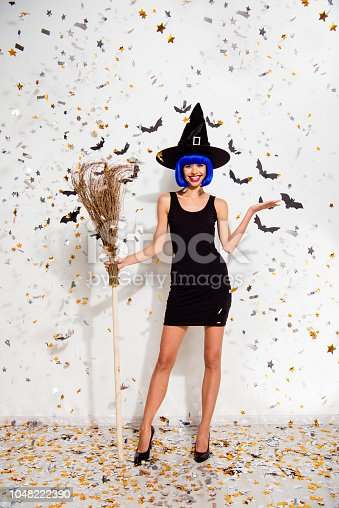 1016084100istockphoto Full length, legs, body, size vertical portrait of beautiful, attractive, excited, dream, dreamy person stand with wooden broom in sharp, pumps, modern shine hairdo isolated on white background 1048222390