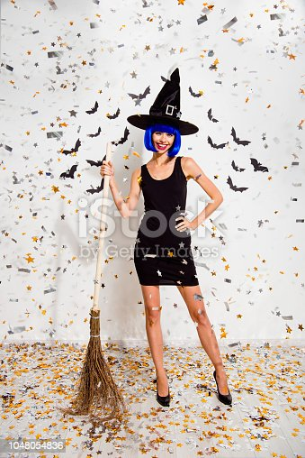 1016084100istockphoto Full length, legs, body, size vertical portrait of careless, carefree lady hold broom in hand and make big smile on red lips isolated on white background in stilettos, shoes 1048054836