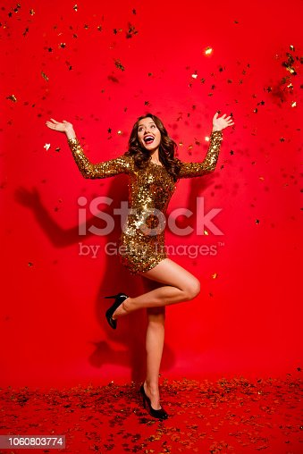 Full length, legs, body, size vertical portrait of glad, funny, funky, laugh lady with modern wave hairdro on sharp, pumps, stilettos raised hands up stand isolated on shine red background