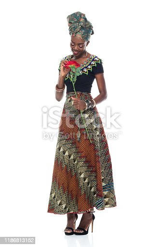 istock Full length of 20-29 years old african ethnicity / african-american ethnicity female / young women wearing headscarf / dress / traditional clothing who is love - emotion / smiling / happy / cheerful / romance / valentine's day - holiday 1186813152