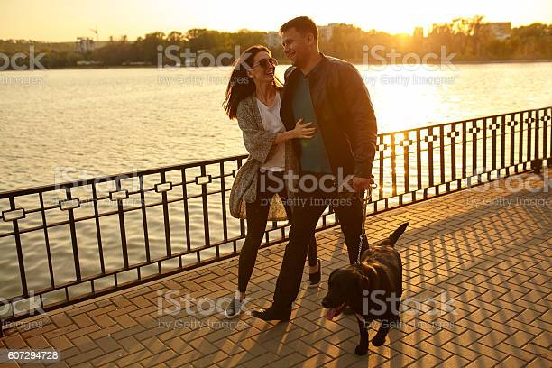 Full length of a happy couple walking dog picture id607294728?b=1&k=6&m=607294728&s=612x612&h=ebnzjbpuyxcix30v2n6tcndw1 hoa29odwh9d1dh0vs=