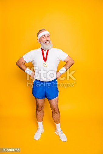 istock Full length of active modern cool funny grandpa with arms on waist. Body, health, care, lifestyle, game, challenge, champ, hero, leisure, training, workout, strength, power 928899268