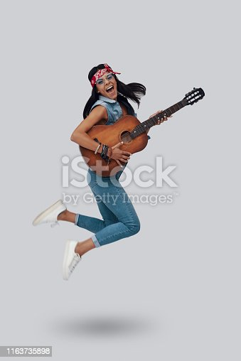 istock Full length of attractive stylish young woman 1163735898