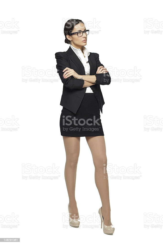 Full length of business woman standing with folded hands stock photo