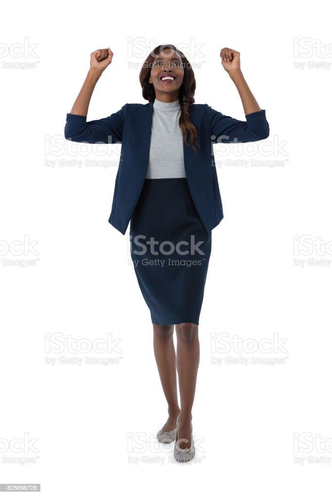 Full length of cheerful businesswoman stock photo