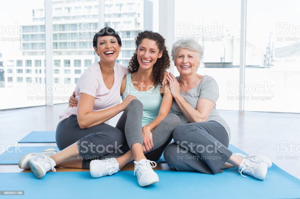 Full length of cheerful women in yoga class stock photo