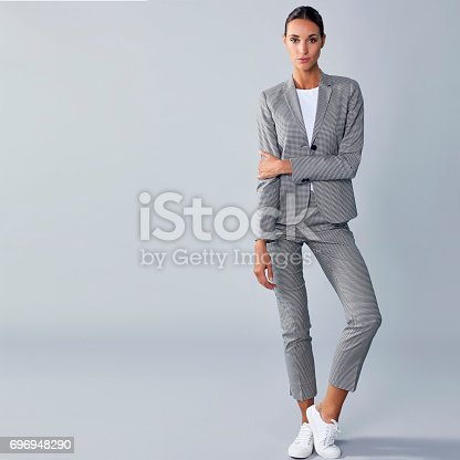 istock Full length of confident businesswoman holding arm 696948290