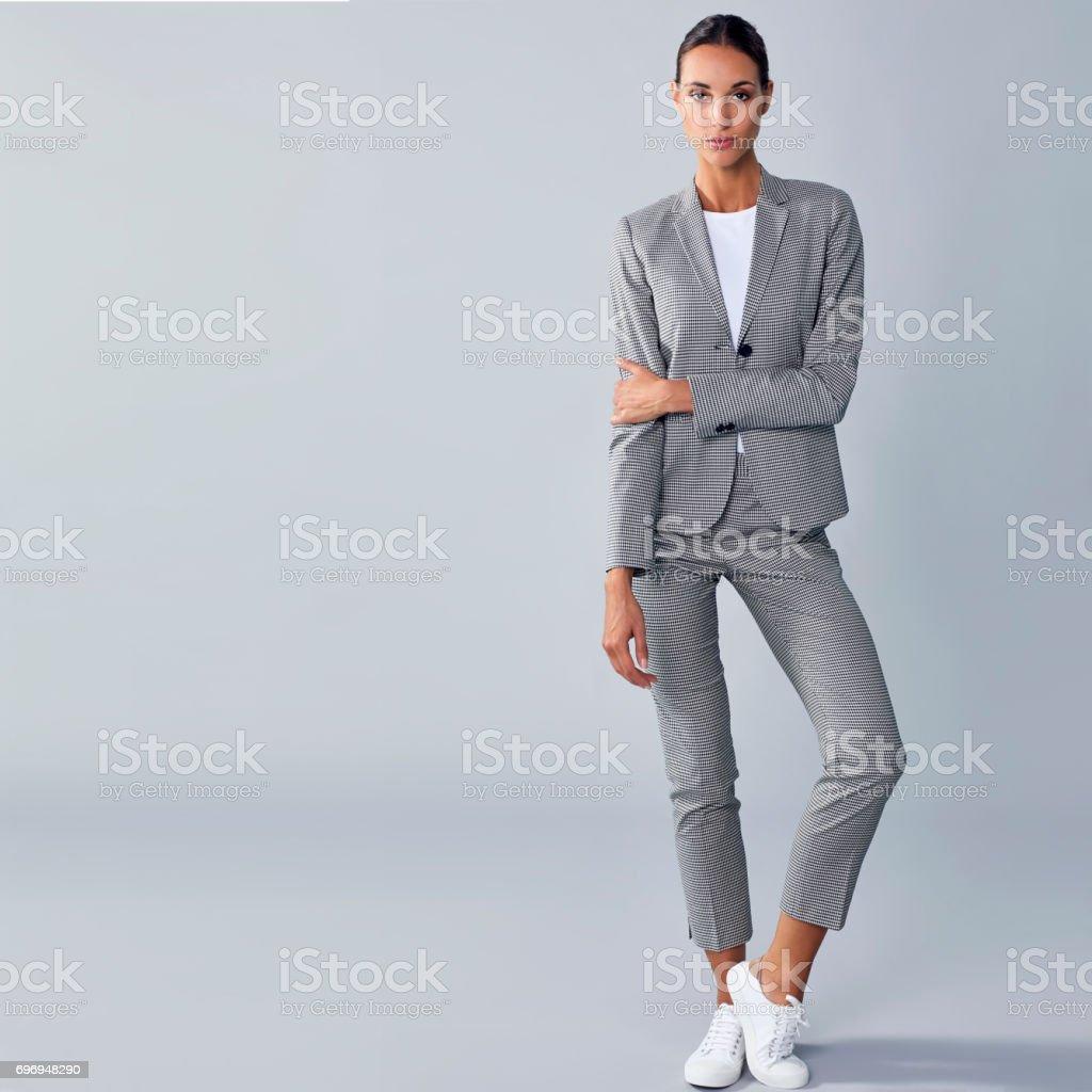 Full length of confident businesswoman holding arm stock photo