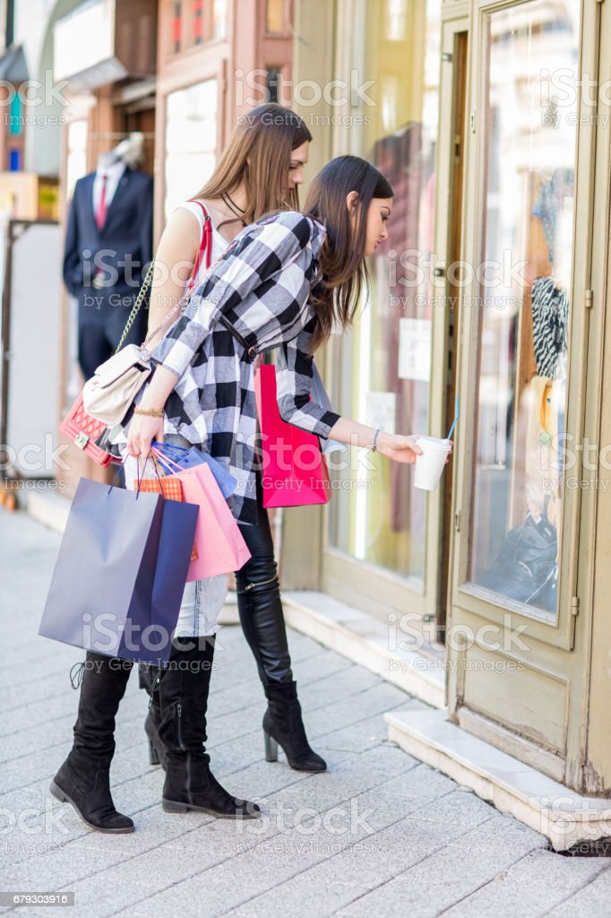 Full length of fashionable women shopping in the city. royalty-free stock photo