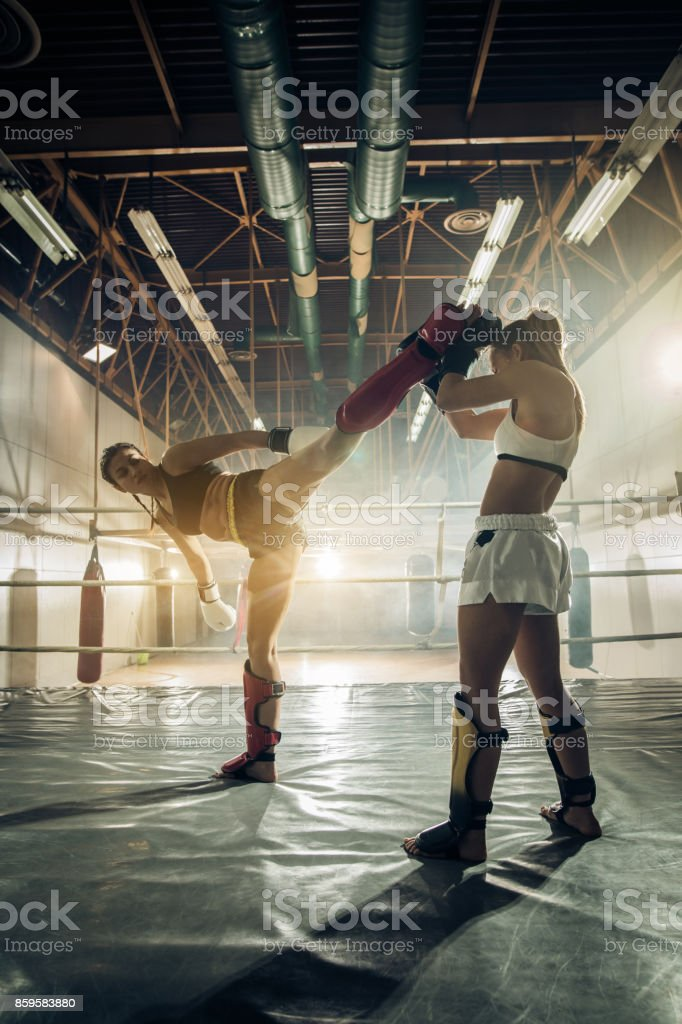 Full length of female kick boxers in a ring during sports training. stock photo