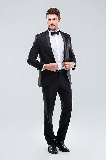 Full length of handsome young man in tuxedo with bowtie – Foto