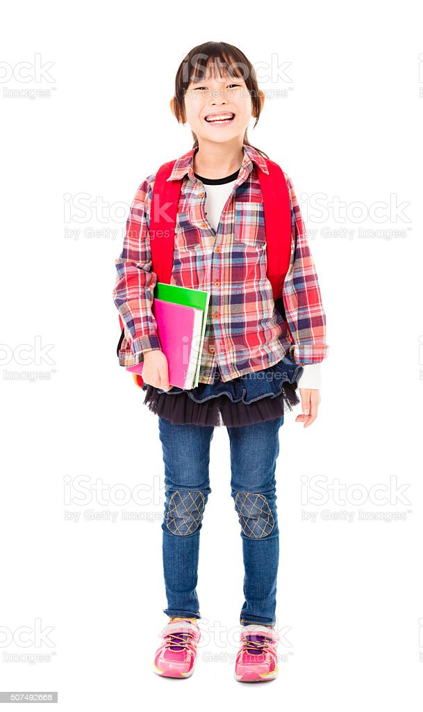 full length of happy little girl holding books stock photo