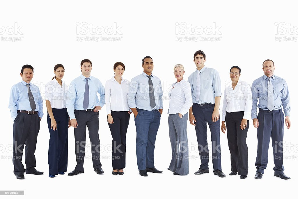 Full length of office colleagues standing in line stock photo