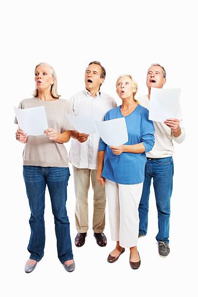 full length of senior people singing together against white - full length of senior people singing together against white stock photos and pictures