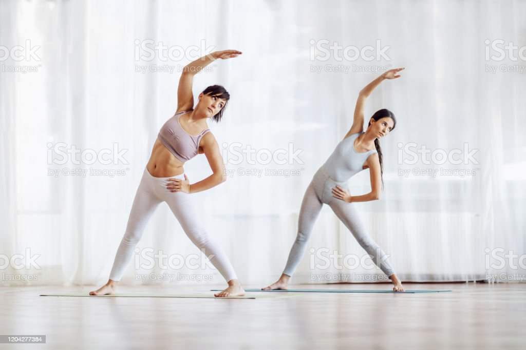 Full Length Of Two Fit Slim Attractive Young Women Standing With Split Legs And Hands On Hips On The Mat In Yoga Studio Stock Photo Download Image Now Istock Pain pinballed from her lower back to her groin to her hip. https www istockphoto com photo full length of two fit slim attractive young women standing with split legs and gm1204277384 346452974