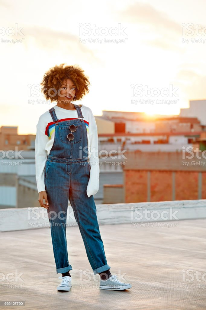 Full length of woman standing on terrace in city stock photo