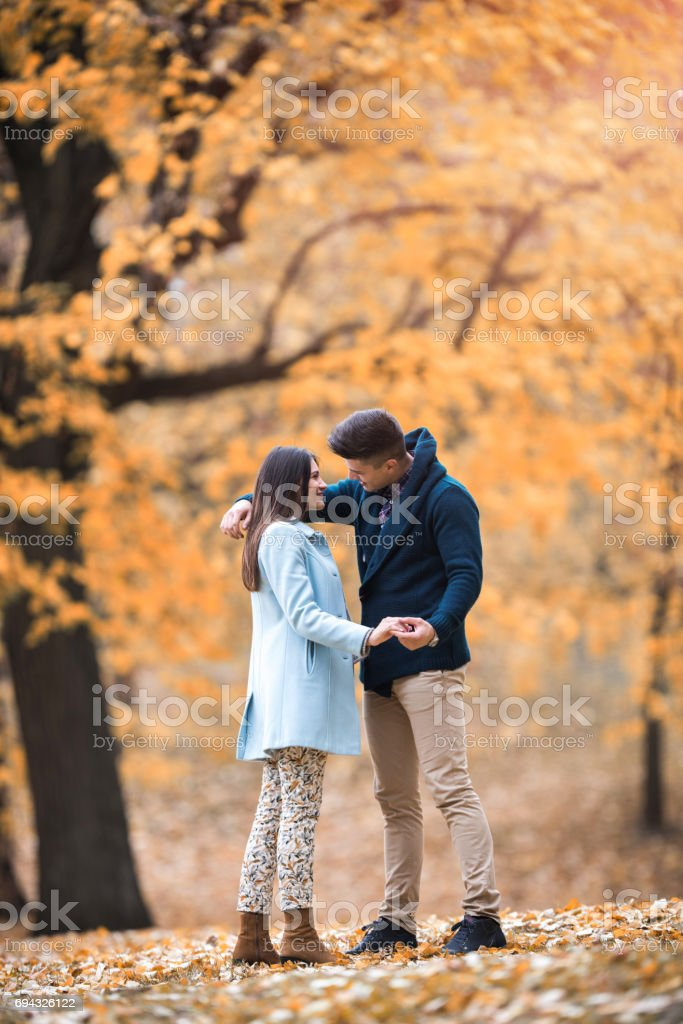 Full length of young affectionate couple in the park. stock photo