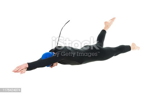 Full length / one man only / one person / side view / profile view of 30-39 years old handsome people caucasian male / mid adult men / mid adult triathlete doing triathlon / swimming / diving into water in front of white background wearing swimming goggles / swimming cap / wetsuit / swimwear