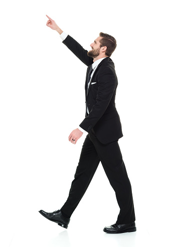 istock Full length / one man only / side view / profile view / looking up of 20-29 years old adult handsome people / tall person brown hair / short hair caucasian male / young men business person / businessman / manager walking in front of white background 1173964617