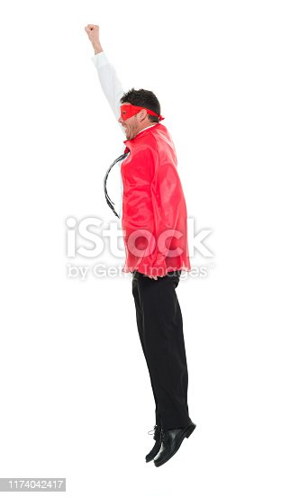 Full length / one man only / side view / profile view of 30-39 years old handsome people caucasian male / mid adult men / mid adult business person / businessman / manager / superhero / hero flying / jumping / mid-air in front of white background wearing cape - garment / costume / eye mask / mask - disguise / lumberjack shirt / button down shirt / shirt / necktie / pants who is conquering adversity / serious / confidence / concentration / joy / excited and showing fist who is courage with arms raised / superman - superhero