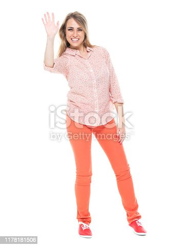 Full length / one person / front view of 20-29 years old adult beautiful caucasian young women / female standing in front of white background who is smiling / happy / cheerful / cool attitude and greeting