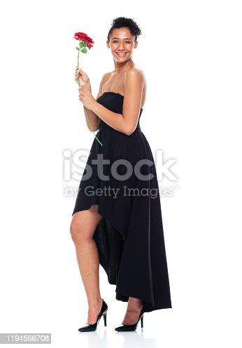 istock Full length / one person / front view of 20-29 years old adult beautiful african ethnicity / african-american ethnicity female / young women standing wearing dress who is smiling / happy / cheerful / love - emotion / cool attitude 1194566708