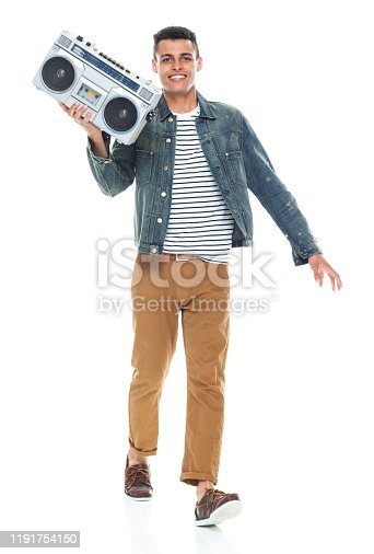 Full length / one person / front view of 20-29 years old adult handsome people / tall person african ethnicity / african-american ethnicity male / young men dancer dancing / exercising wearing denim jacket who is smiling / happy / cheerful / joy / listening / cool attitude and holding boom box / personal stereo / music / old-fashioned / party - social event