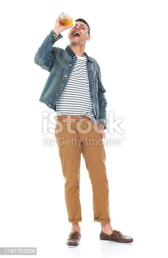 istock Full length / one person / front view of 20-29 years old adult handsome people / tall person african ethnicity / african-american ethnicity male / young men standing wearing denim jacket who is smiling / happy / cheerful / drinking / cool attitude 1191754209