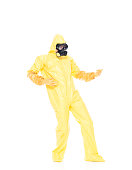 Full length / one person of 20-29 years old adult handsome people / slim caucasian male / young men rock musician bending / dancing in front of white background wearing protective workwear / gas mask / mask - disguise / radiation protection suit / protective suit who is imagination / singing / cool attitude who is doing air guitar and holding guitar / radioactive contamination / music