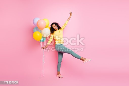 istock Full length photo of beautiful pretty dreamy lovely careless enjoy love like have good lucky mood holding many baloons in hand walking straight in casual jumper isolated pastel pop color background 1179357505