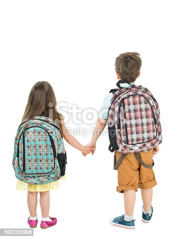 istock Full Length Photo Of Little School Girl And Boy Walking 592003998