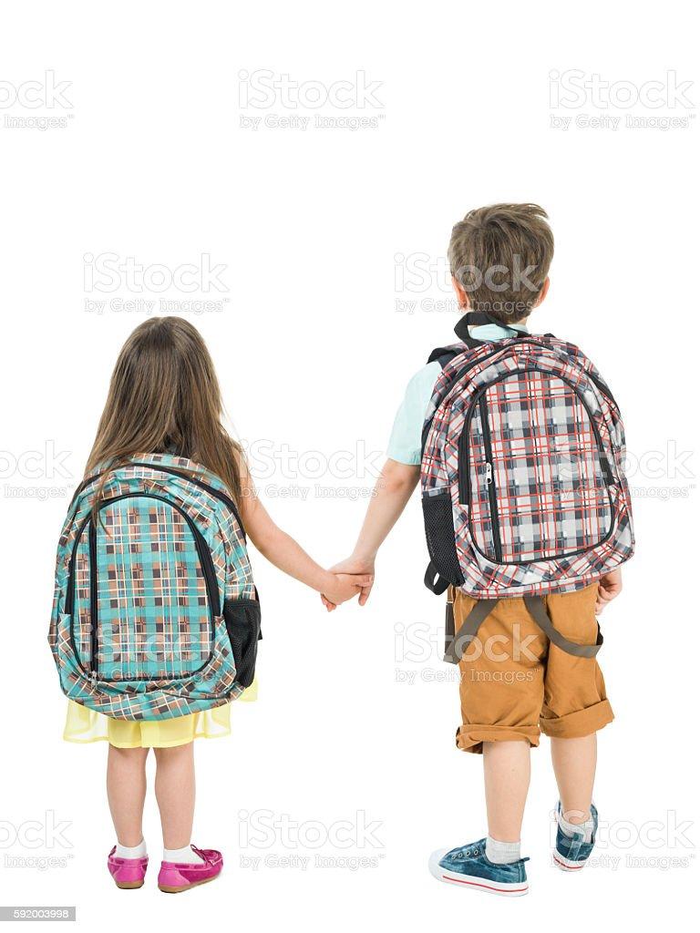 Full Length Photo Of Little School Girl And Boy Walking stock photo