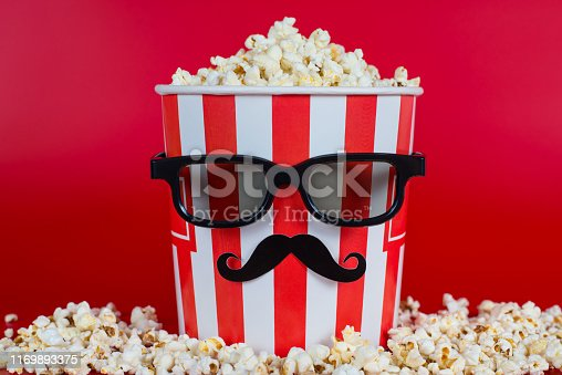 istock Full length photo of one looking like a human tasty delicious salty yummy sweet taste popcorn with black vr modern fashionable eyeglasses isolated vivid background 1169893375