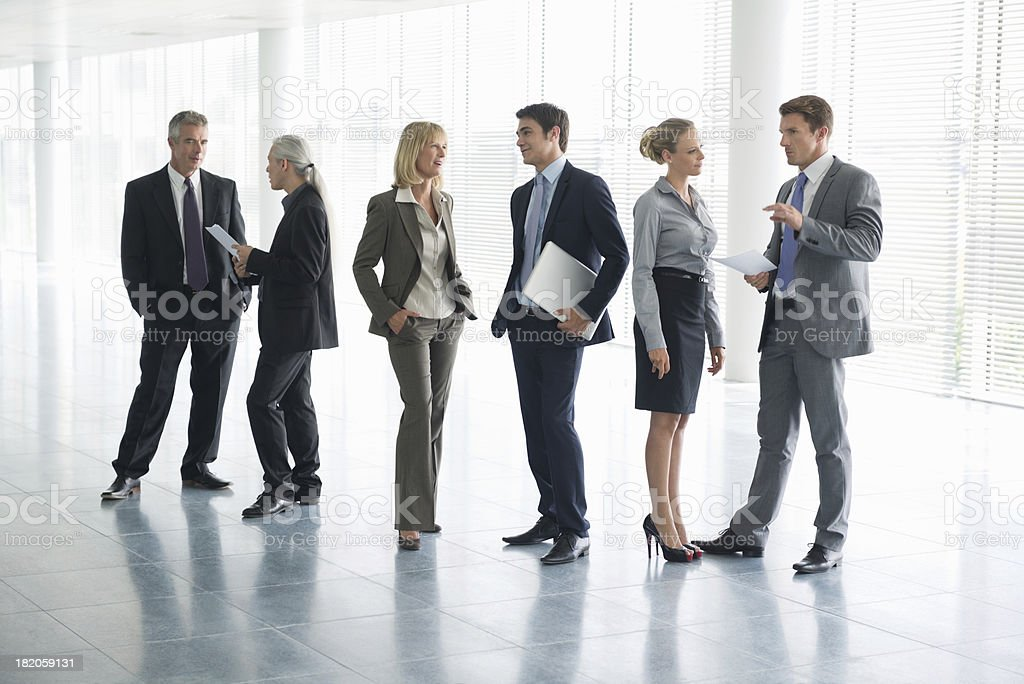 Full length picture of business people in conversation stock photo