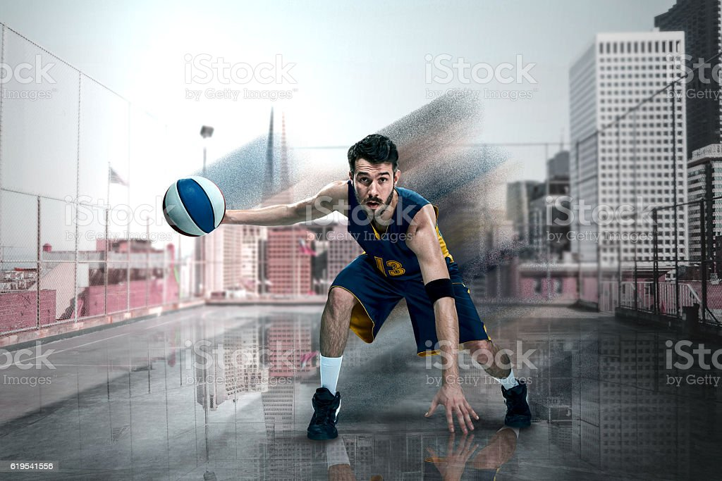 Full length portrait of a basketball player with ball stock photo