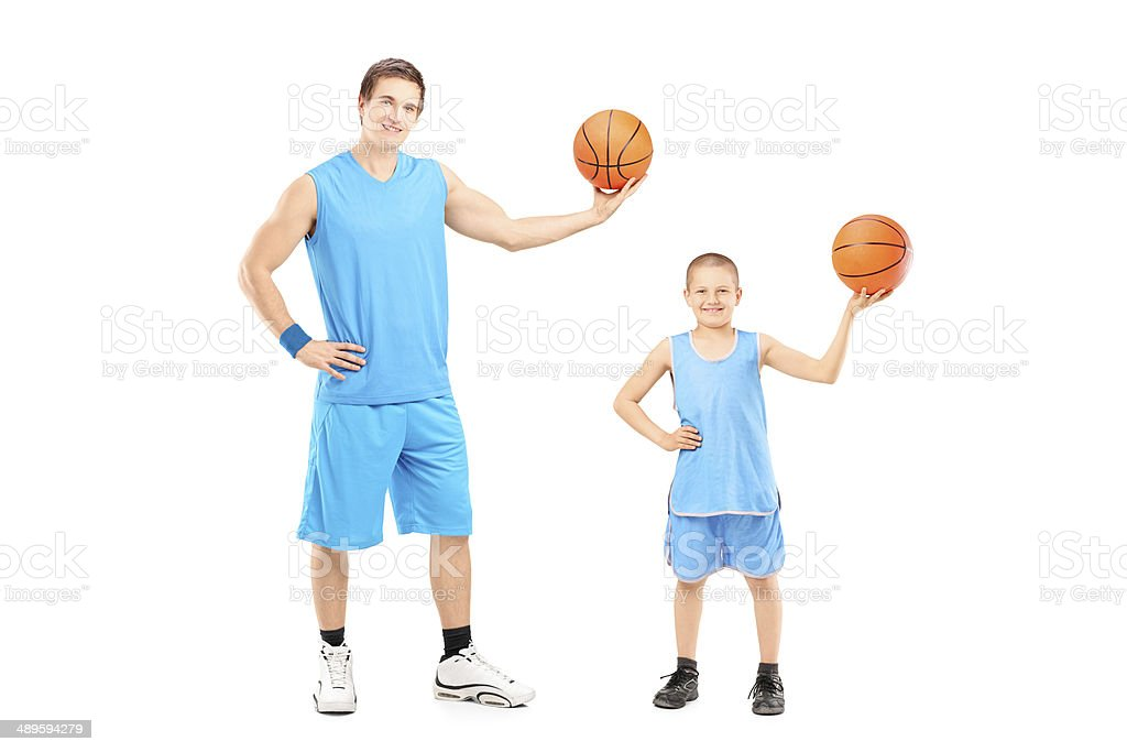 Full length portrait of a basketball players posing isolated on white...