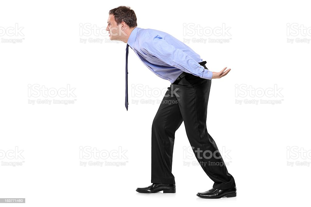 Full length portrait of a businessman carrying something imaginary royalty-free stock photo