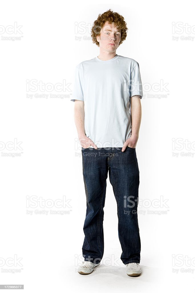 Full length portrait of a casually dressed anxious teenage boy stock photo