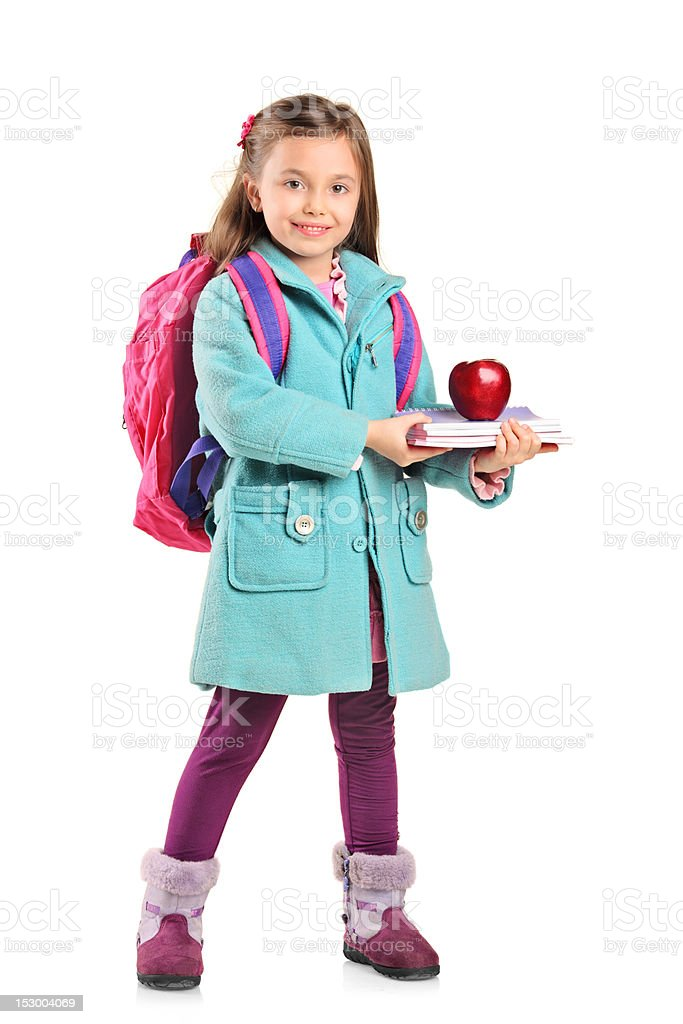 Full length portrait of a child holding books and apple royalty-free stock photo