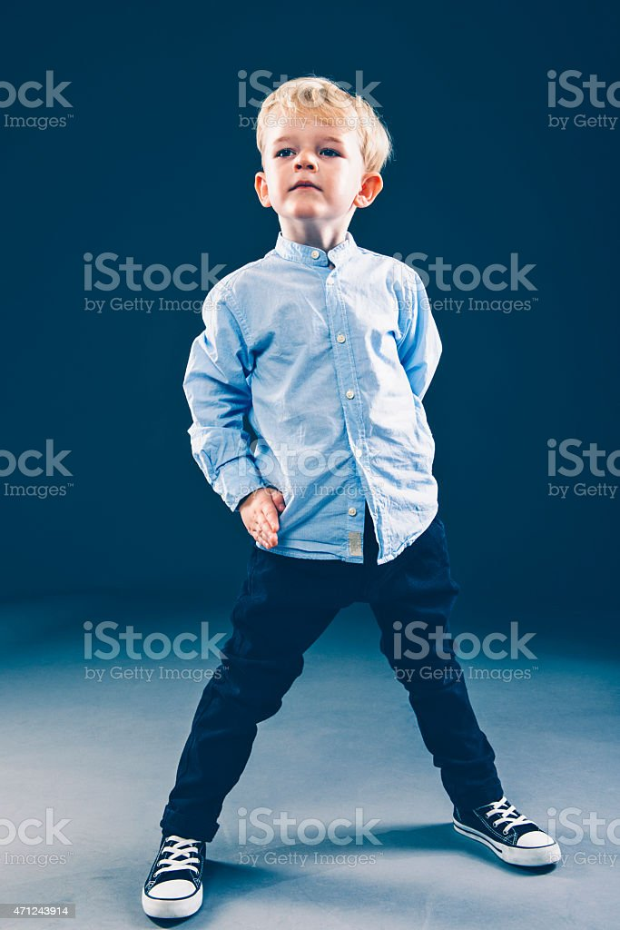 Full length portrait of a confident boy with an attitude stock photo