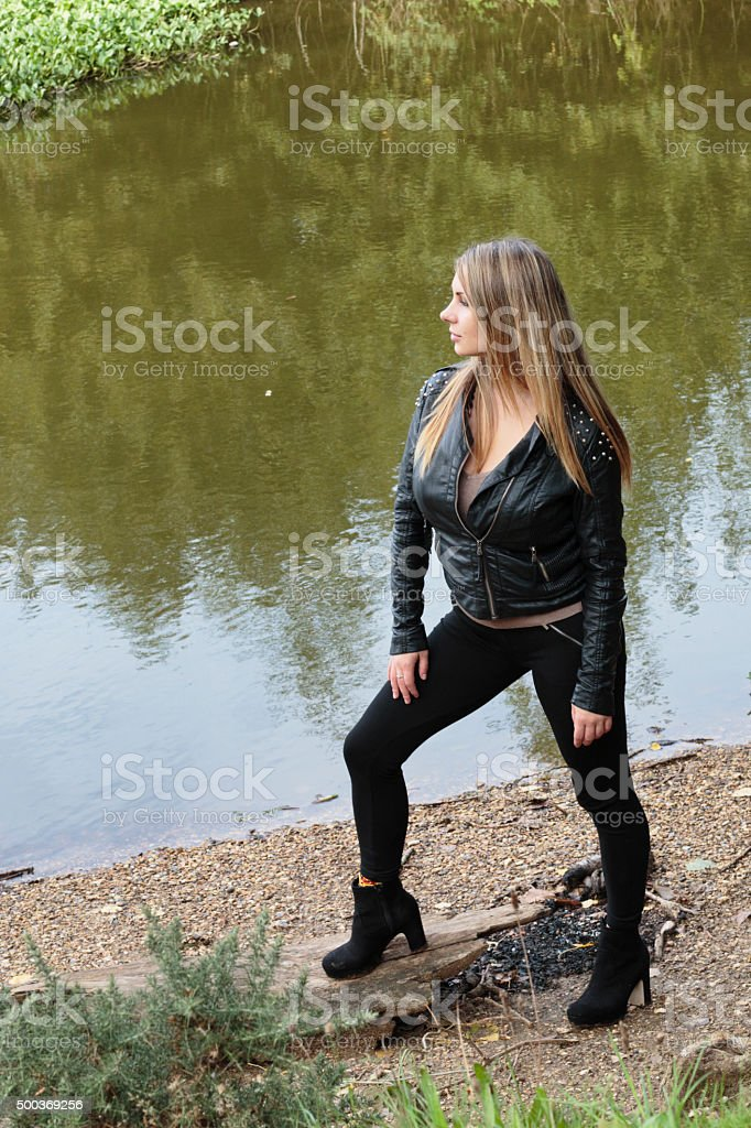 Challenging upright stance of confident outdoor Polish girl stock photo