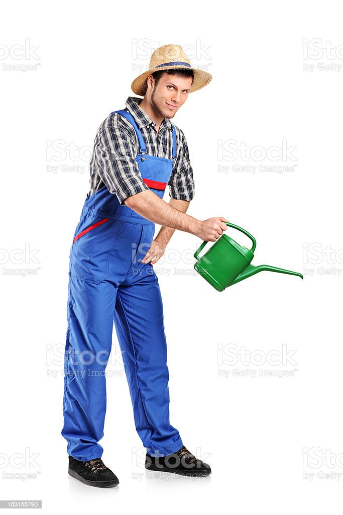 Full length portrait of a gardener with watering can royalty-free stock photo