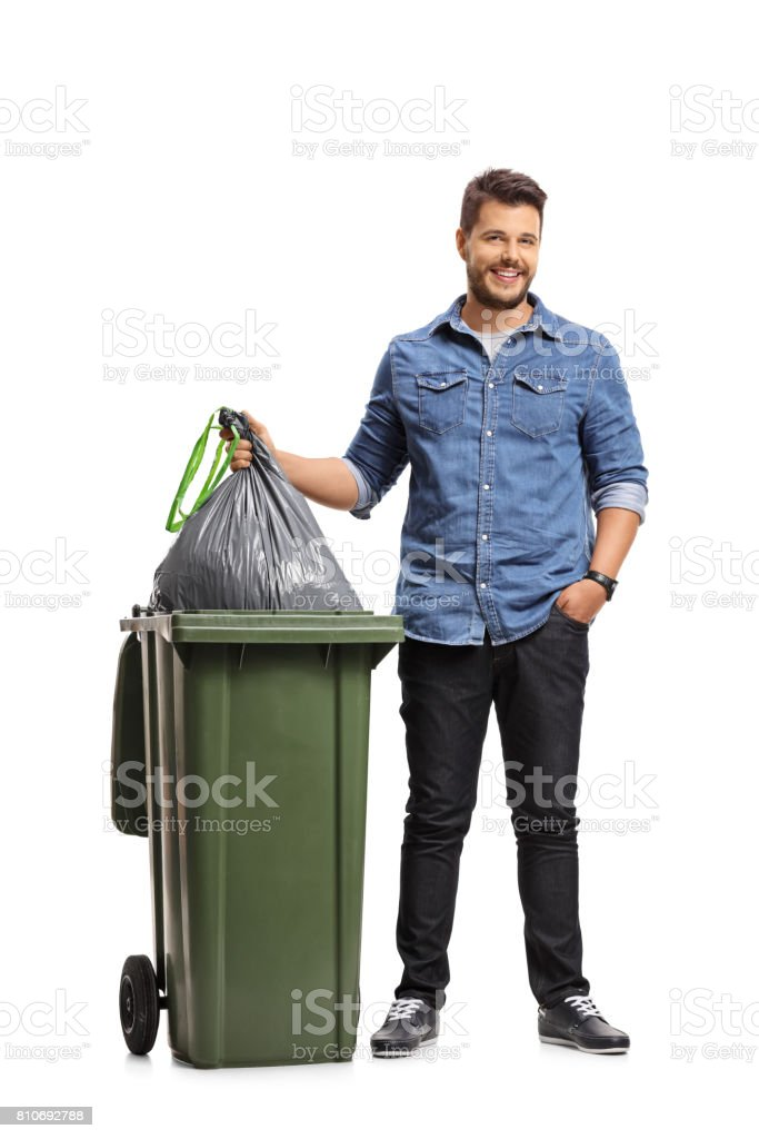 Full length portrait of a guy taking out the garbage stock photo