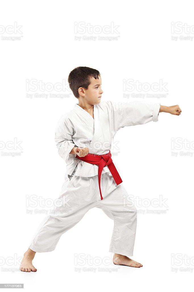 Full length portrait of a karate child posing stock photo