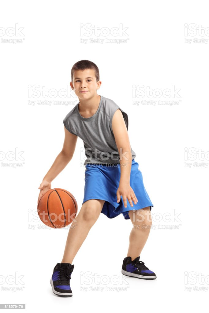 Full length portrait of a kid playing with a basketball stock photo