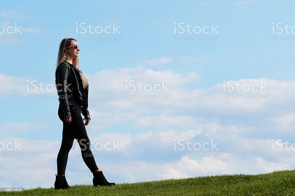 Shapely woman walking against the sky outdoor Polish girl stock photo