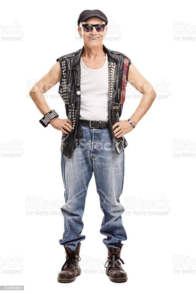 Full length portrait of a senior punk rocker stock photo